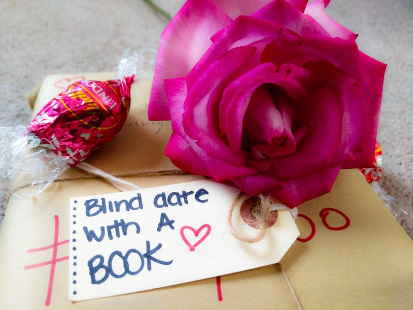 Blind date with a book with a tag and rose